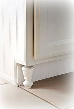 "this is such a great, inexpensive idea to spruce up builder-grade cabinetry. finials instead of expensive ""cabinet feet."" and the beadboard along the toe kick looks really custom as well. definitely doing this in the kitchen and the bathrooms."