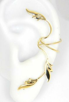 Gold Vermeil 3 Delicate Leaves Full Ear Cuff for Left Ear Ear Charms. $65.95. For the Left ear.. Designed and made in the USA. Pierceless - requires no piercing.. Made of sterling silver covered with gold vermeil.