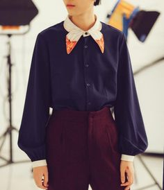 FineArt Collection.  Dark blue shirt with butterfly collar, the collar part is designed as butterfly wings, the orange color brights with the dark blue base. The sleeves are designed as vintage lantern style, not very exaggerate way puffy but elegant way. The cuff part is simple white corresponding