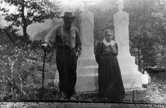 Anse and Levicy (Vicey) Hatfield stand in front of their sons Troy and Elias Hatfield's graves in the Hatfield Cemetery, Sarah Ann, Mingo County, W.V. (Mingo was divided from Logan County)