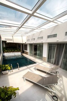 house #ARNdesign , penthouse pool design ,  penthouse design , interior pool ,  grass ceilling ,  pool ,  glass roof ,black pool , interior design ,