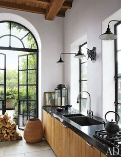 A Touch of Black… - Design Chic - great kitchen = love the black steel doors