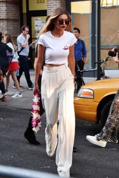 graphic shirt and creme palazzo trousers