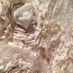 Beauty in texture! A close up of the detailed rows of hand sewn fabrics, pleated and gathered.  Our Designer One of a Kind Gown, Flora. A couture piece from one of our runway shows.  If you are looking for a unique gown, this one is truly couture!