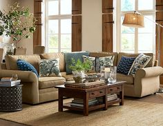 Love the end table, the accent pillows, coffee table décor and the lamp - potterybarn