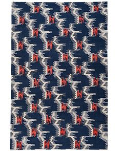 """Petal Power- Inspired by antique Japanese textiles, Carrier and Company created Water Lilies, a flatwoven wool rug, for Studio Four NYC. Measuring 6"""" x 9"""", it costs $2,600; other sizes are available. Indigo, one of three colorways, is shown.  studiofournyc.com"""