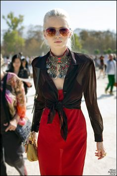 Necklace is incredible. Love how it accentuates the bold red of the dress as well as the tinted shades. Very cool.
