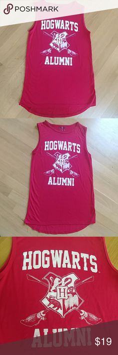Harry Potter Hogwarts Long Tee Shirt EUC Harry Potter/Warner Brothers/ Hogwarts Tee Shirt or Sleep Shirt. Bright Red with White Lettering & Super Soft.  26in from Shoulder to Hem. 15in from Armpit to Armpit. Children's Large, but could Easily be Women's XS. Harry Potter Shirts & Tops Tank Tops