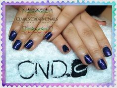 CND Shellac Midnight Swim layered with Dazzling Dance. By Claire's Creative Nails, Northampton. Call or text: 07752 397245 to book your appointment. #shellac #northampton #NailSalon #cnd #SparklyNails