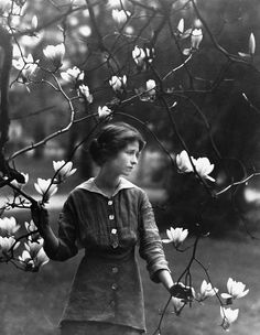 """Edna St. Vincent Millay, 1914; photograph by Arnold Genthe; The Gardens of Their Dreams by Robin Lane Fox: """"Wishful thinking is entwined with gardening. We plant, we dream, we fantasize about flowers, and we see behind them the people who once gave them to us or first showed us their beauty, and then others to whom we showed them and gave them lovingly all over again."""" Read More:"""