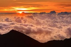 Sunrise on Mt. Haleakala in Maui, Hawaii.  10,000 feet........The most beautiful sunrise you will ever see. Everyone MUST do this:)