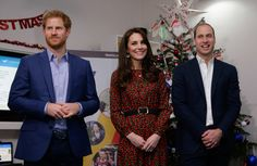 Kate Middleton Photos Photos - (L-R) Prince Harry, Catherine, Duchess of Cambridge and Prince William, Duke of Cambridge stand ready to give an award during a visit to a Christmas party for volunteers at The Mix youth service on December 19, 2016 in London, England. The Mix youth service works with Their Royal Highnesses' Heads Together Campaign. - The Duke And Duchess Of Cambridge & Prince Harry Attend The Mix Christmas Party