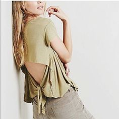Free people flowy open back casual top Only worn once, in perfect condition! Color is a light olive. It is super lightweight and flowy. In love with this top but I never wear it Free People Tops
