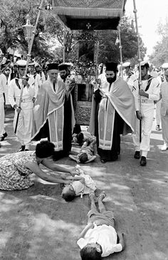 GREECE. Ionian Islands. Corfu island. Procession of St Spyridon. Children are laid on streets where the relics pass to be blessed. 1962. Rene Burri