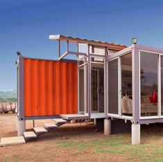 Cargo container home closeup. I would want an orange one just like this.