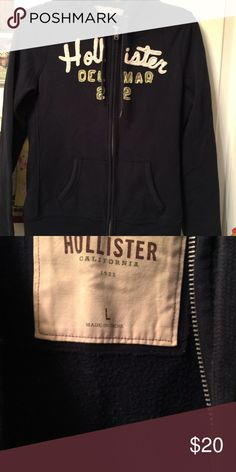 Hollister hoodie Hollister zip up hoodie, Navy blue with white and lime green printing, Front pockets & soft warm velvet inside, size large, gently used, very good condition Hollister Jackets & Coats