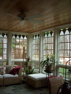 cute sun porch - wood ceiling - glass at top of windows.