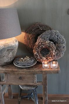 I like the idea of grouping the wreaths (and also the entire rustic, weathered barn-board theme)