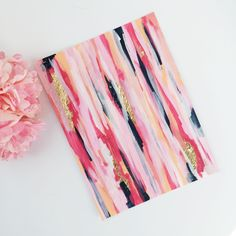 An abstract piece of art done in hues of dark pink, light pink, coral, navy, white, with flecks of gold foil. The gold foil also creates great depth and texture. Would look beautiful as a stand alone piece framed, or you could also add it to a gallery wall! Could also be great decor for a b...