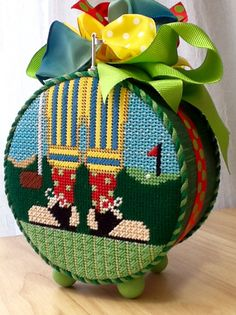 Lynn C. stitched these cute legs. Four!golf feet needlepoint canvas, The Meredith Collection