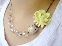 Yellow owl and flower necklace