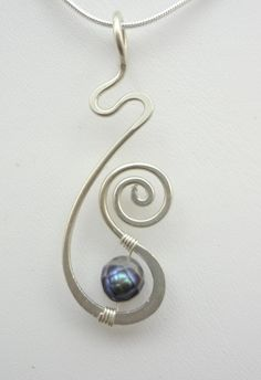 Sterling Silver and Pearl Freeform Hammered Wire Wrapped Pendant. $25.00, via Etsy. by Jersica