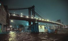 Flooded Streets Under The Manhattan Bridge  Streets are flooded under the Manhattan Bridge in the Dumbo section of Brooklyn, N.Y., Monday, Oct. 29, 2012.Sandy continued on its path Monday, as the storm forced the shutdown of mass transit, schools and financial markets, sending coastal residents fleeing, and threatening a dangerous mix of high winds and soaking rain. (AP Photo/Bebeto Matthews)