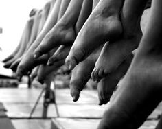 Dancer and gymnast feet work hard and feel the heat over the years