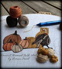 Harvest Thyme In Olde New England by Vermont Harvest Folk Art by Doreen Frost  A folksy sawdust stuffed Pillow of A dapper Tom hanging out in his abundant Pumpkin Patch.  Done in gorgeous variegated Valdani (size 8) Pearl Cotton Floss in rich Autumn colors.  **THREADS USED** Valdani Pearl Cotton floss Size 8 ~ One ball EACH of the following colors;  H207~Darkened Blue,  0578~Primitive Blue,  O571~Tea Honey, O196~Muddy Bark,  P9~Bronze  TWO balls; P4~Aged White Light…