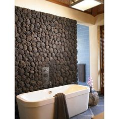 Amie loves this lava rock wall in the bathroom but I think it's a flop. What do you think? #DesignDebate #GoliathCompany #FlippingVegas