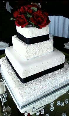 Elegant Square Wedding Cake but with gold ribbon instead of black...and a letter instead of flowers on top.