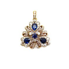 Late 19th century sapphire and diamond trefoil cluster pendant brooch by Tiffany, c.1890  of triangular outline, formed of three pear shaped sapphires in heart shaped diamond borders, diamond ribbon loops between, a six-point star cut sapphire to the centre, hinged and detachable diamond set suspension loop, open set in gold