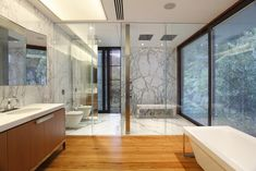 Carrara marble and wood. Dream bathroom.