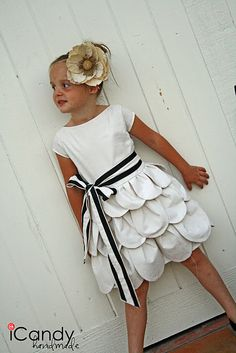 Adorable petal dress - made from an old sheet. Not a full tutorial but does briefly explain how she put it together.