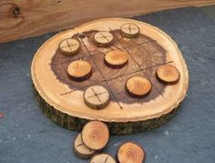 No need to uproot that old tree stump. Leave it in the ground and turn into an outdoor game board for all-ages classics like Tic-Tac-Toe and checkers. Wood Crafts, Diy And Crafts, Crafts For Kids, Arts And Crafts, Cabin Crafts, Wood Slice Crafts, Wood Projects, Woodworking Projects, Craft Projects