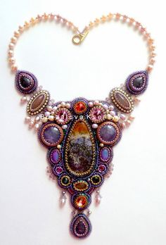 Ksenia Burzalova is russian beadwork artist. She makes beautiful embroidered jewelry,  every piece has pretty charm and deep beauty.
