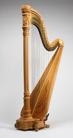 Lot# 1040 A Lyon & Healy style 23 concert grand harp. Manufactured Under Eight Patents'', maple body with spruce soundboard with gilt-acanthus scroll decals and seven-pedal mechanism, 74'' H x 38.5'' W x 35'' D, est: $800/1200 *Price Realized: $3,368.75