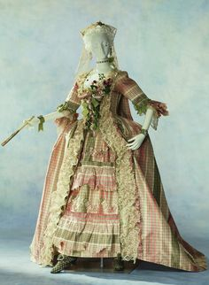 Dress (Robe à la française)  1760 The woman's dress of the 18th century is characterized by the light pastel color and the decorations...