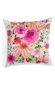 Vibrant, painterly blooms wash across this fresh and fabulous accent pillow by Kate Spade.