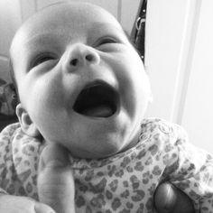 Little Emmy Grace giving daddy her first smile
