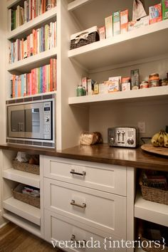 Pantry features pull out baskets, ample storage, and built-in microwave with coo… Pantry features pull out baskets, ample storage, and built-in microwave with cookbook storage above - Own Kitchen Pantry Kitchen Pantry Design, New Kitchen, Kitchen Storage, Kitchen Decor, Kitchen Ideas, Kitchen Shelves, Cookbook Storage, Cookbook Shelf, Microwave In Pantry