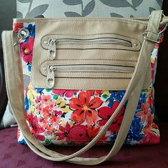 Bright Floral Handbag Gorgeous colorful floral handbag. Medium sized. Very roomy. Strap can be adjusted to be used as a crossbody. In great condition.   * sorry no trades  * bundle and save  * feel free to make offers  * smoke free home Bags Crossbody Bags