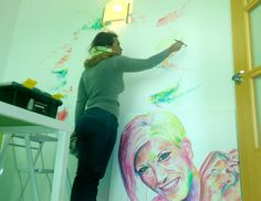 Painting a wall. Nohemy Correa. Portrait.