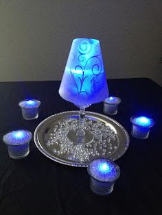 Wine glass with vellum paper lampshade.  LED tealight to make it blue - brilliant idea!