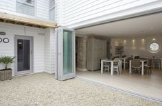 sunroom courtyard | bi-fold doors from kitchen to gravel courtyard | Luxury small hotel by ...
