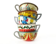 Tin Toy Teacups, yes--I had some of these along w/the whole set of dishes (wish I still had them now)!