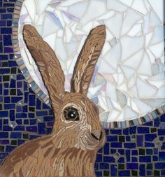 Moonlit hare set as relief to night sky.