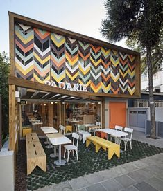 Came across this lovely exciting and fresh cafe and bakery based in Porto  Alegre in Brazil. This is a truly contemporary interior design but with a  few more rustic elements to offer a great relaxed atmosphere. The most  obvious feature of Padarie is the colourful facade covering the first floor