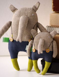 Elephant is made from 100 % natural linen. Inside - polyester stuffing.  * Hand embroidered body Elephant is about 21cm x 9cm /8,2 x 3,6 inch.   Please give me 1- 14 working days to make it. This elephant can be an excellent birthday gift or home decoration.