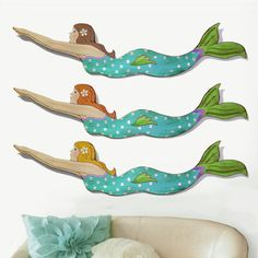 """Hand Painted Wooden Mermaid 46"""" long and about 13"""" high.  Hanging hardware on the back.  Pick your mermaid by hair color."""